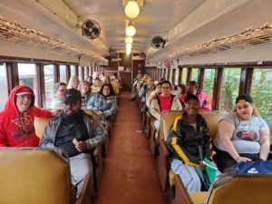 Group of Dayton Club members and staff on train